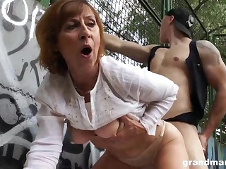 Mature dame is gargling sausage in a public place and getting poked rigid, in suffice for