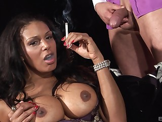 Classy busty ebony smokes greatest extent possessions pussy flouted