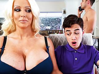 Busty stepmom interested to taste schoolboy's dick